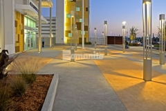 This two-tone checkerboard pattern was created by incorporating Bomanite Integral Color into over 132,000 SF of decorative concrete paving at the Tanger Outlets Daytona to create the likeness of a racetrack infield and because the color added into the mix is uniform throughout the depth of the concrete, the color will remain that same as the concrete wears.