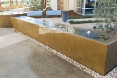 This beautiful and peaceful water feature design was created using Bomanite integrally colored concrete that was installed with a smooth trowel finish to complement the tranquil and therapeutic design aesthetic.