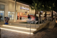 Bomanite Alloy was installed here to create this decorative concrete step plaza and handicap ramp with exposed seashells that add a reflective quality that enhances the beachy vibe of the Tanger Outlets Daytona.