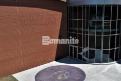 This stunning hardscape surface was created using Bomanite Alloy decorative concrete for a highly durable paving surface that adds a distinctive shine to the outside of this school.