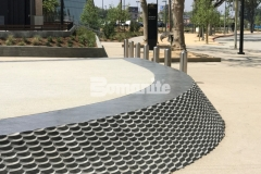 Our associate, Bomel Construction Company, used Bomanite Alloy Exposed Aggregate to create contrasting bands of decorative concrete at the LAFC Banc of California Stadium, incorporating clear glass aggregates and reflective mirror flakes to add intricate, eye-catching detail to the hardscape surface.