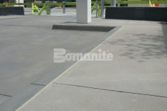 Bomanite of Tulsa skillfully installed Bomanite Alloy at the ONE OK Plaza to create a concrete paving surface with beautifully exposed aggregates for a durable surface that has a distinctive and decorative finish.