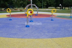 I love the bold statement that Bomanite of Tulsa created at the Manion Park playground space by installing Bomanite Revealed Exposed Aggregate decorative concrete with a mixture of red, blue, yellow, green, and orange glass aggregates because it creates a vibrant hardscape that children are sure to love.