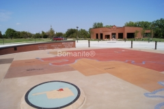Bomanite of Tulsa expertly crafted this stunning decorative concrete hardscape using both Sandscape and Revealed Bomanite Exposed Aggregate systems, creating a distinctive visual display that is a feature piece at the Standing Bear Museum.