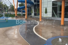 Bomanite of Tulsa used Bomanite Revealed Exposed Aggregate with custom colored glass and Bomanite Sandscape Texture in Gobi Desert to create a decorative concrete hardscape that is extremely durable and adds beautiful character to the waterpark area at the Tandy Family YMCA.