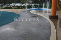 Bomanite of Tulsa installed Bomanite Revealed Exposed Aggregate to create a vibrant decorative concrete hardscape that adds charm and character to the outdoor play space at the Tandy Family YMCA.