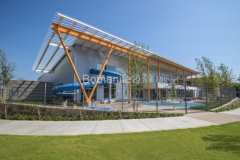 The Tandy Family YMCA Splash Garden at the primary front entrance of the newly renovated facility by Bomanite of Tulsa using Bomanite Exposed Aggregate and Bomanite Revealed concrete is a beautifully modern success story.