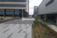Bomanite Con-Color in Cobblestone Gray, Nickel Gray, and Natural Gray was combined with Bomanite Sandscape Texture decorative concrete to add color, pattern, and texture to the hardscape surface for a finished product that is durable and distinctively beautiful.