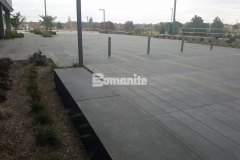 Sandscape Texture decorative concrete by Bomanite was installed in gradient tones of gray con-color with perfectly executed joint lines for a hardscape surface that is distinctively attractive and showcases the beauty of quality architectural concrete.