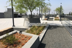 A gray Bomanite Exposed Aggregate Sandscape Texture finish was added to these planters to create texture and detail that complements the other beautiful design elements on this rooftop terrace.
