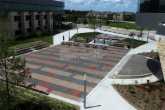 This stunning decorative concrete features a detailed stain pattern that was paired with Bomanite Sandscape Texture decorative concrete to add visual appeal to the hardscape while complementing the surrounding architecture and creating visual continuity throughout the space.