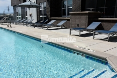 The pool coping at the COLAB Co-Housing Development was created using Bomanite Sandscape Texture decorative concrete and the Sandscape finish child safety grip edge coordinates well with the other hardscape finishes in this outdoor gathering space.