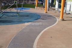 Bomanite of Tulsa concrete is both functional and inviting at the Tandy Family YMCA Splash Garden using both Bomanite Exposed Aggregate and Bomanite Revealed concrete.