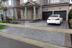 Our associate Bomanite Toronto installed this stunning stamped concrete driveway and front porch entrance for a Burlington, Ontario homeowner and their use of Bomanite Imprint Systems and the Bomacron Yorkshire Stone imprint pattern created a unified design that won them the Silver Award in 2017 for Best Bomanite Imprint Project under 12,000 SF.