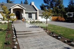 Bomanite Bomacron stamped concrete was installed here by our colleague Heritage Bomanite and the English Sidewalk Slate imprint pattern that runs the length of the driveway and front entryway is a beautiful accent to the old-world charm and European flair at this Fresno, California home.