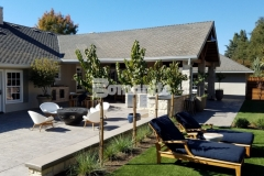 Beautiful color chemistry was achieved here by utilizing Bomanite Sand Color Hardener and Bomanite French Gray Release Agent with Bomanite English Slate imprinted concrete, drawing out the stamped texture and unifying the design aesthetic in this backyard retreat.