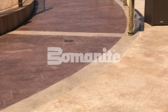 Bomanite Imprint Systems were used here to create a stamped concrete hardscape and this stunning Bomacron Boardwalk pattern offers the look of wood planking while providing durability and adding beautiful design detail to this outdoor space.
