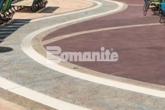 This decorative concrete decking features Bomanite Imprint Systems, including multiple Bomacron patterns that unite perfectly to create contrast and add dimensional detail throughout the Castaway Island water feature in Canobie Lake Park.