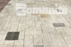 Bomanite stamped concrete was installed here to create a decorative hardscape surface and features Bomacron Ashlar Slate stamped concrete that is bordered by an integrally colored gray band, for a beautiful interplay of color, pattern, and texture.