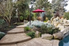 Featured here is the Bomacron Slate Texture pattern that was used to create this beautiful stamped concrete walkway and pool deck and this durable surface brought to fruition the homeowner's vision of a designer outdoor entertaining space.