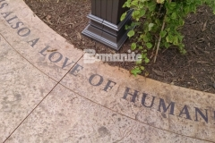 Showcased here is Bomanite Regular Slate imprinted concrete that was etched and then highlighted with Bomanite Con-Color to draw attention to the thought-provoking text in the Dr. Sanford and Lois Benjamin Healing Garden at CMC Mercy Hospital.