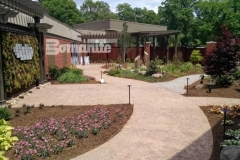 This Bomanite imprinted concrete showcases multiple textures, colors, and Bomacron patterns including Regular Slate and Small Sandstone for a stunning hardscape surface that harmonizes perfectly with the beautiful, tranquil healing garden at CMC Mercy Hospital.