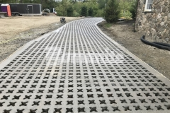 A Bomanite Grasscrete pervious concrete driveway was the perfect choice for this residence because it will maintain strong structural integrity, mitigate drainage issues for the homeowner, and provide a beautiful aesthetic that reflects the exterior design of the home.