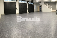 As a solution to a badly poured garage foundation, the Bomanite Broadcast Flake Toppings System was installed in this garage and the salt and pepper finish adds an architectural design element while providing a protective flooring surface that will stand up to long term wear and tear.