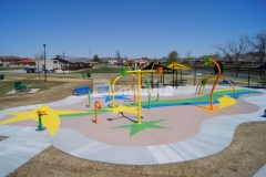 Bomanite of Tulsa skillfully installed this stunning playground hardscape using Bomanite Micro-Top XT, a toppings system that provides a cost-effective way to incorporate multiple colors and complex designs, allowing them to create a distinctive, dynamic, and extremely durable play space at the Jackson Park Playground in Broken Arrow, Oklahoma.