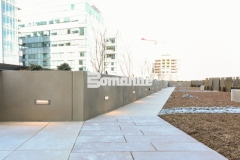 Bomanite Micro-Top ST was applied here as a decorative concrete overlay to create a sand-finished surface over these planter walls and planter boxes and mirror the urban lifestyle design at this mixed-use luxury condominium development.