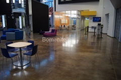 Bomanite of Tulsa used the Bomanite Patene Artectura system with Bomanite Ebony Chemical Stain for this flooring to harmonize with the vibrant, youthful color palette that was used to delineate the student activity zones at the Oral Roberts University Armand Hammer Alumni Student Center.